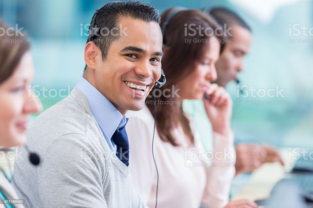 Confident IT support person in call center stock photo