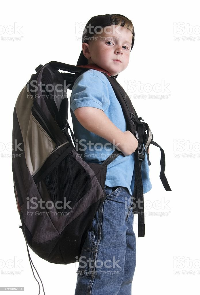 Confident Kindergarten Student Carrying a Large Backpack royalty-free stock photo