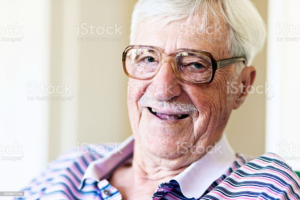 Confident, laughing, 90-year-old man in spectacles stock photo