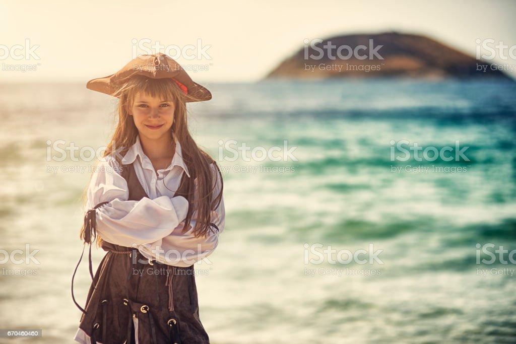 Confident little pirate girl stock photo