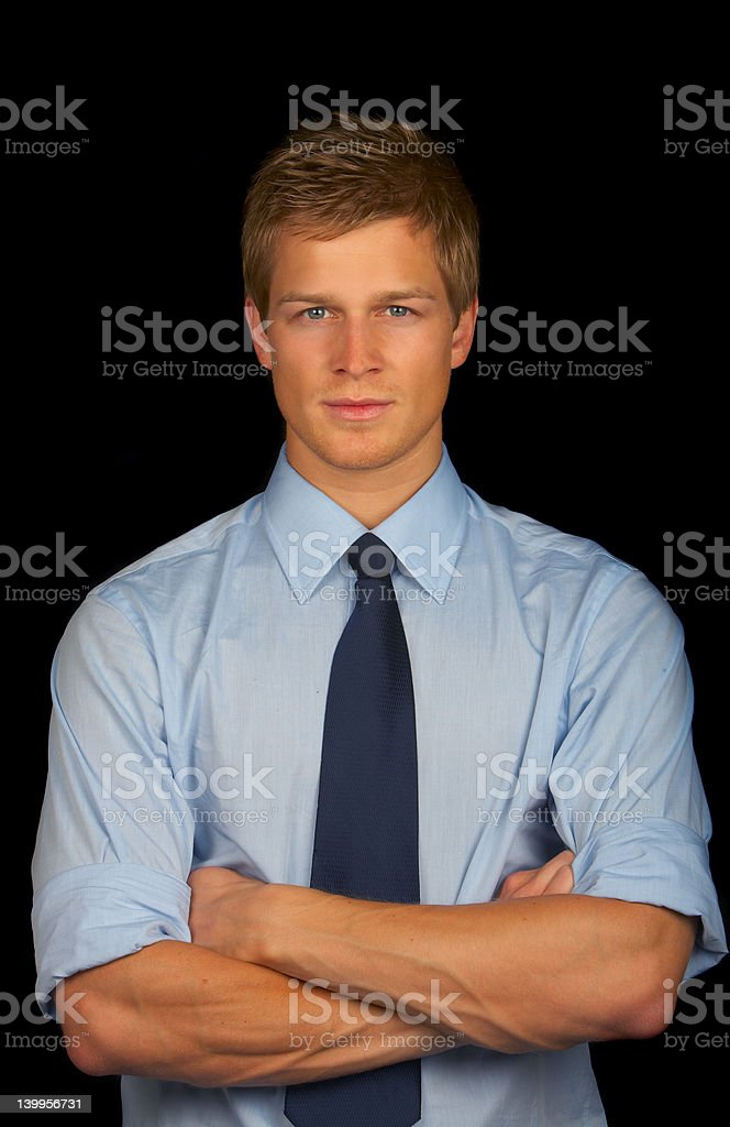 Confident male business executive standing with folded hands royalty-free stock photo