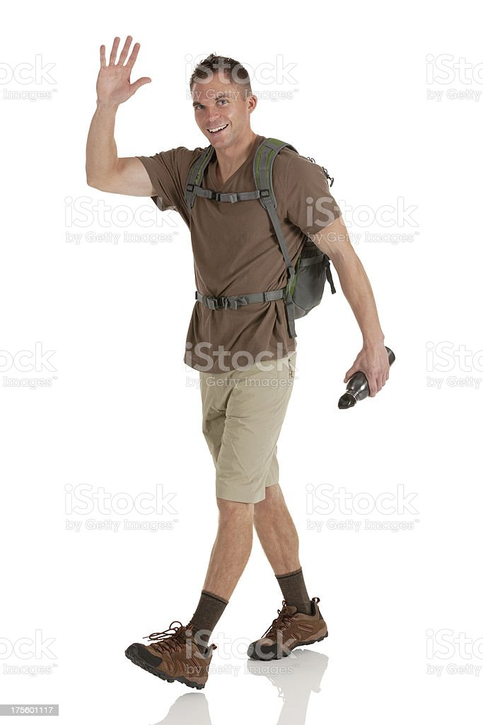 Confident male hiker waving his hand royalty-free stock photo