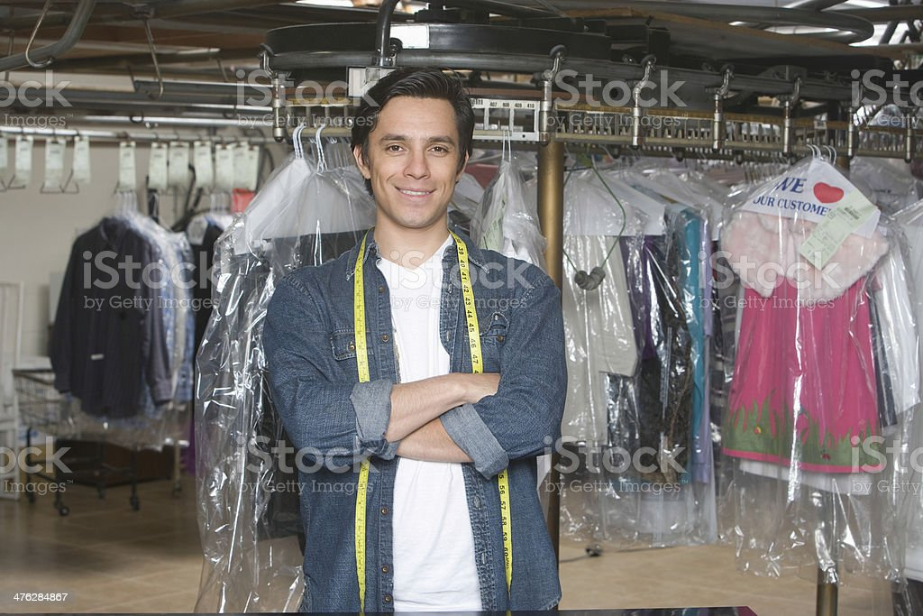 Confident Male Owner Standing In Laundry stock photo