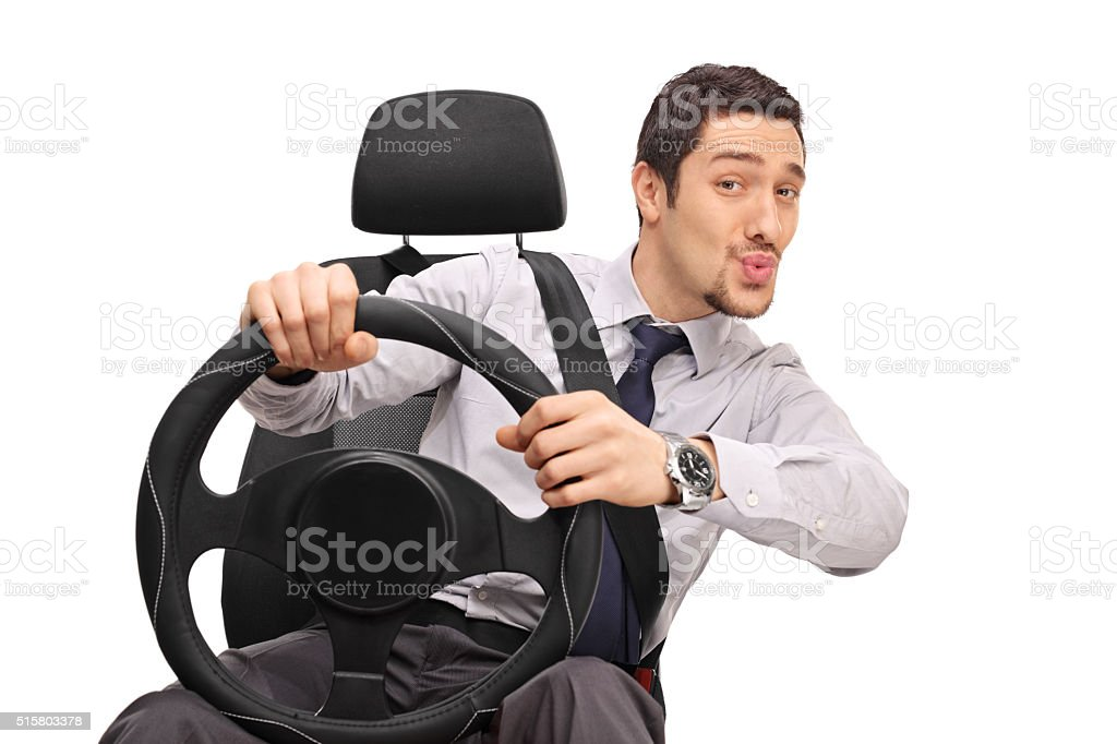 Confident man driving and whistling stock photo