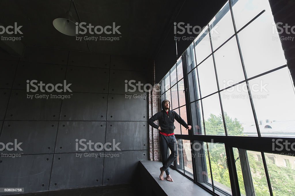 Confident man fit in sports clothes. stock photo