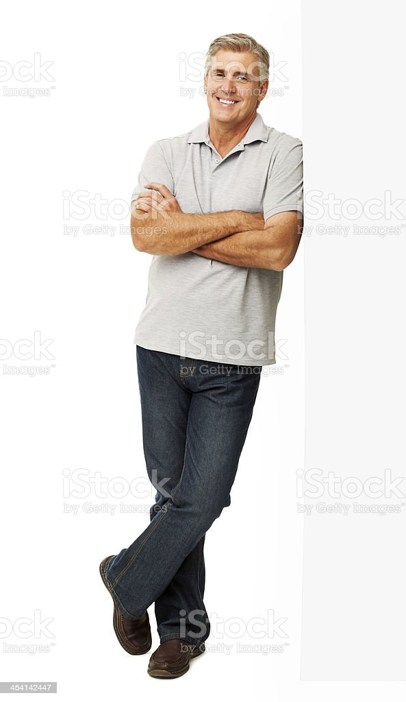 Confident Man Leaning On Billboard stock photo