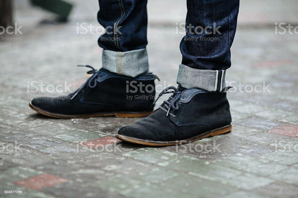 Confident man posing in selvedge  jeans stock photo