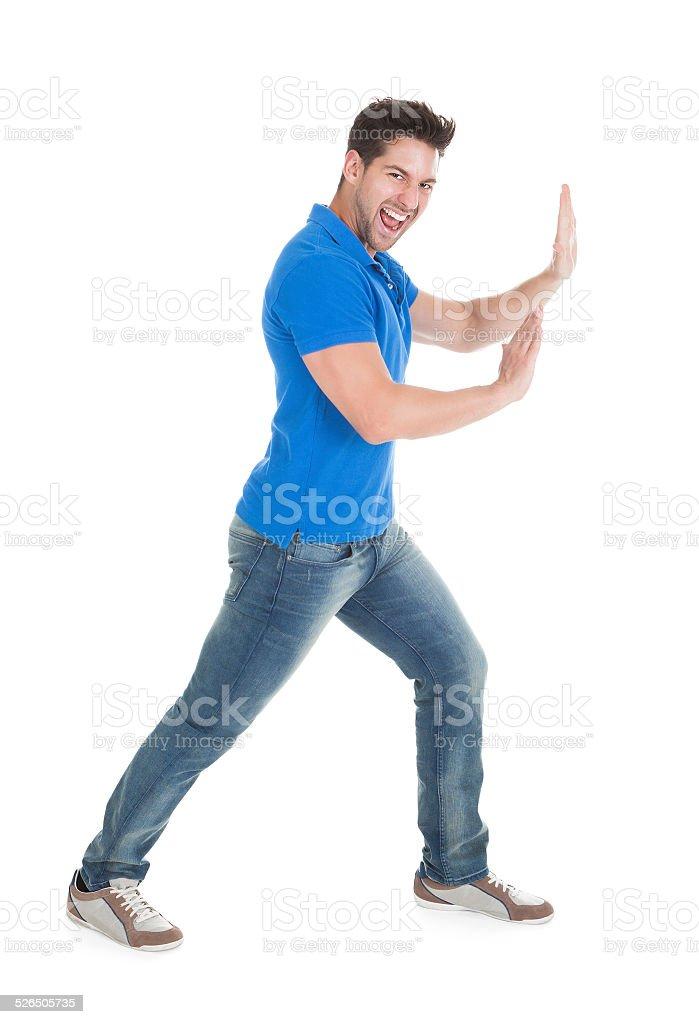 Confident Man Pushing Billboard stock photo