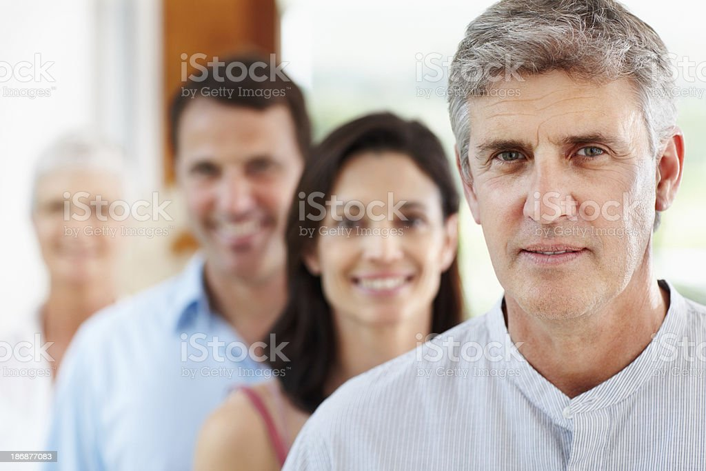 Confident man with his family in a row royalty-free stock photo