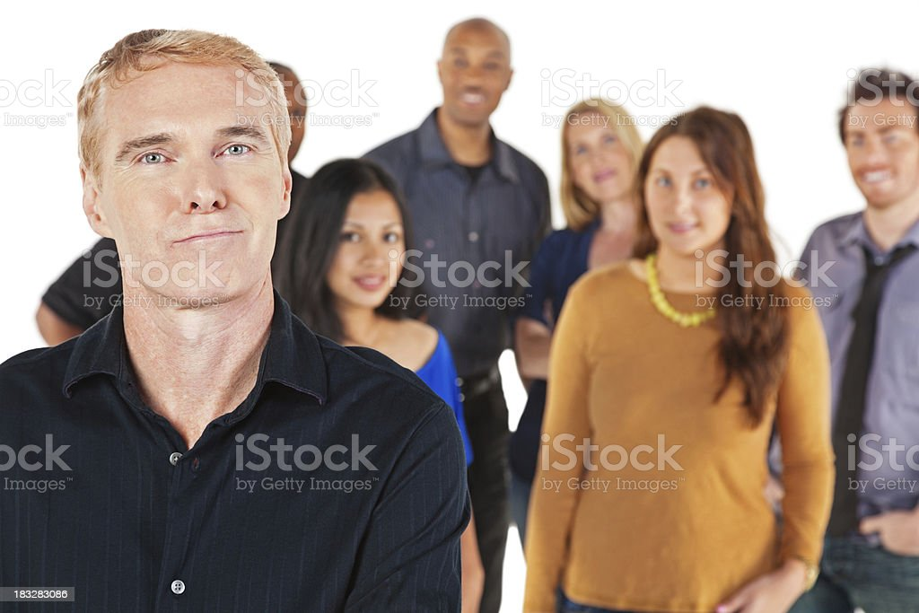 Confident Man With People Behind Him royalty-free stock photo