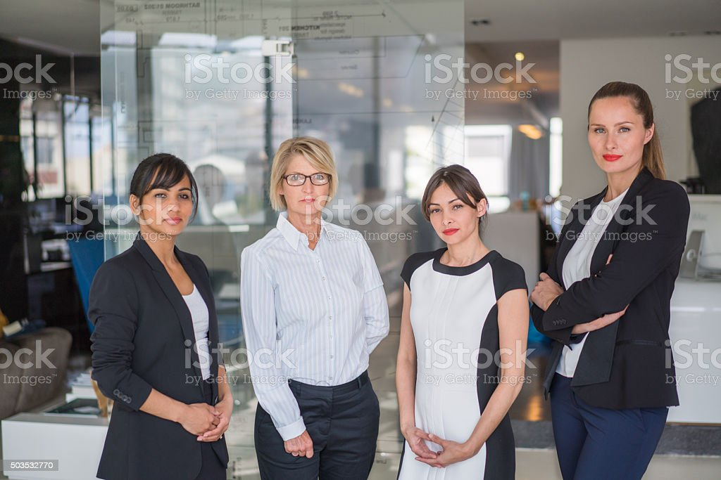 Confident manager standing with executives stock photo