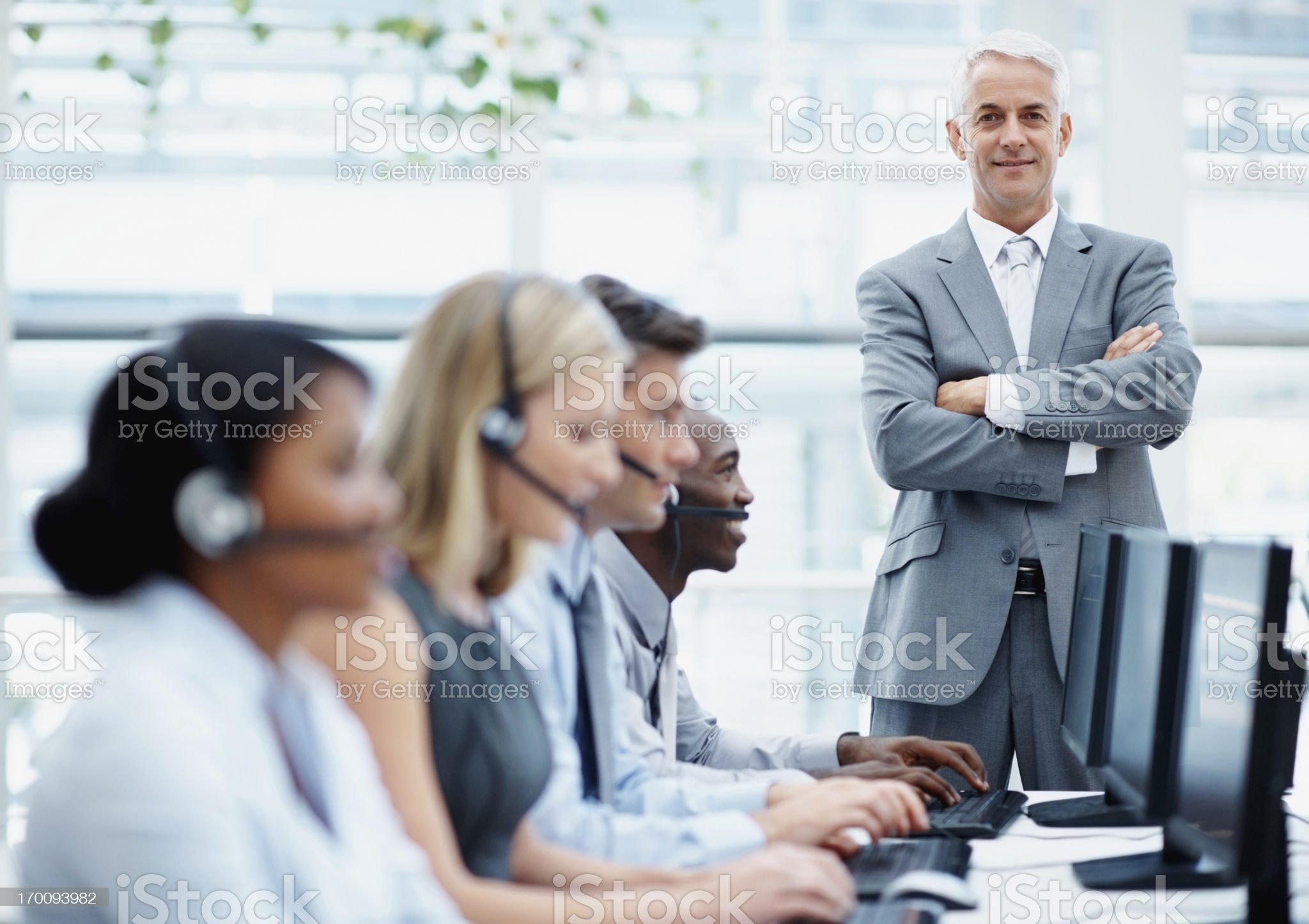Confident manager with young business team at a call center royalty-free stock photo
