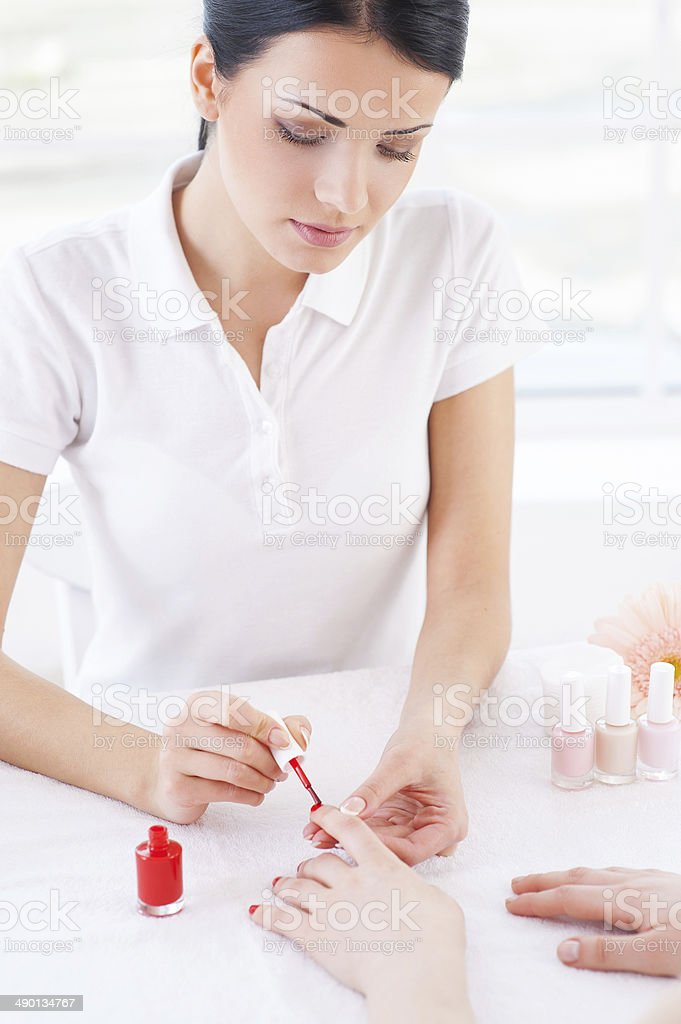 Confident manicurist at work. royalty-free stock photo