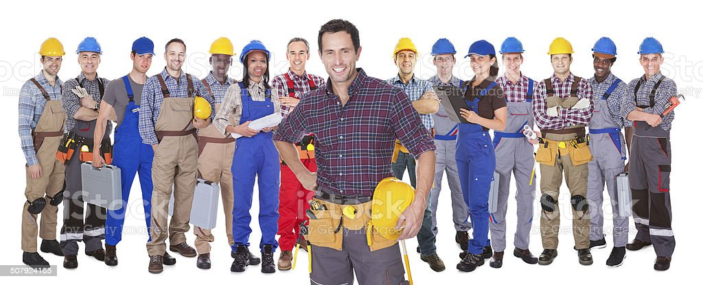 Confident Manual Workers Against White Background stock photo