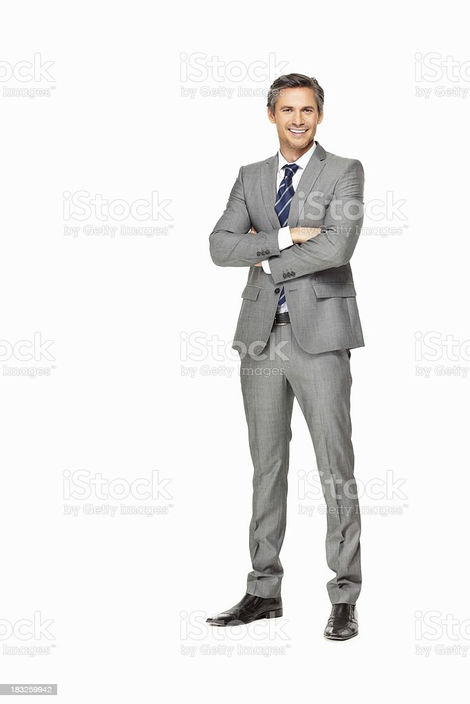 Confident mature business man with hands folded smiling stock photo