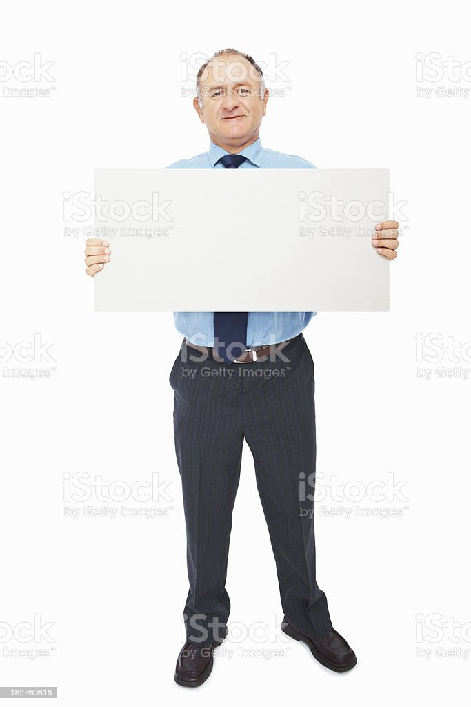 Confident mature businessman holding a blank billboard royalty-free stock photo