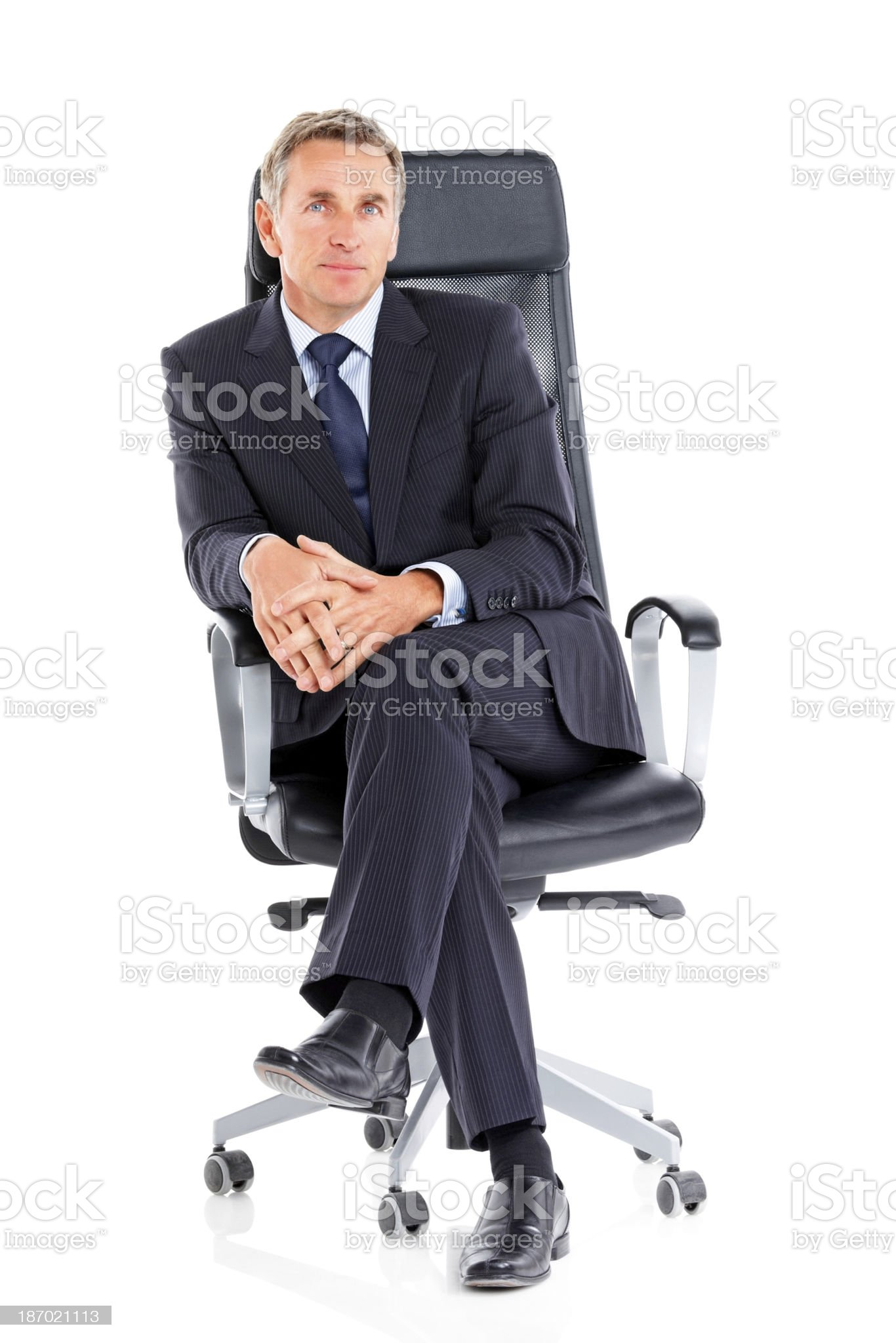 Confident mature businessman sitting on office chair royalty-free stock photo