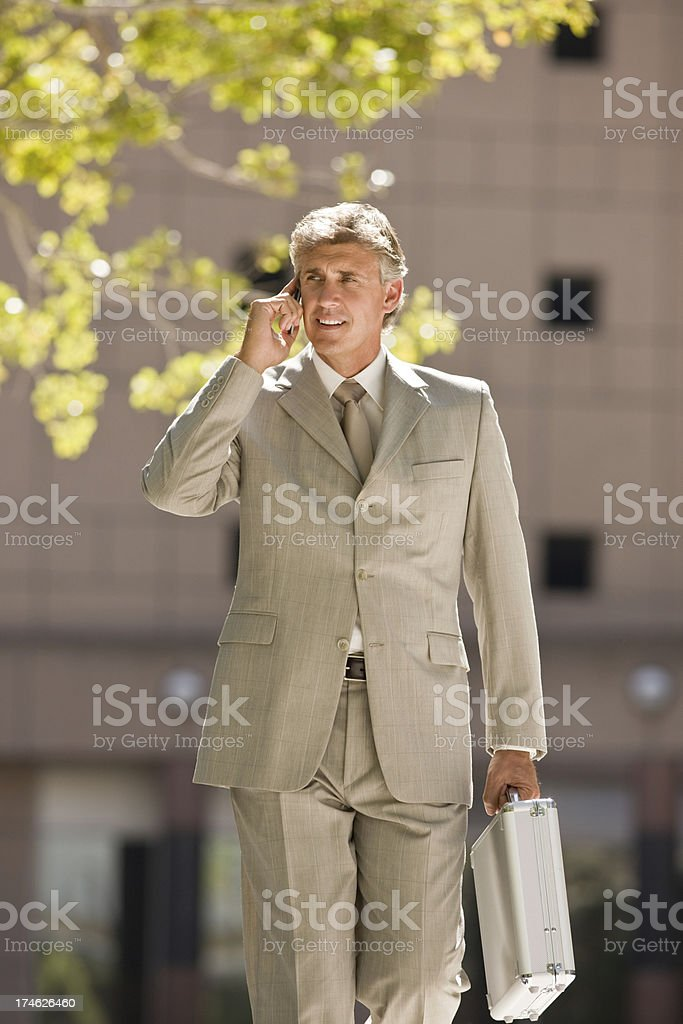 Confident mature businessman talking on cellphone royalty-free stock photo