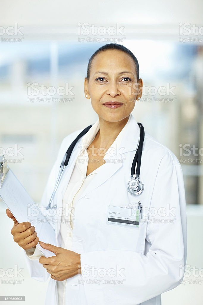 Confident mature female doctor holding reports royalty-free stock photo