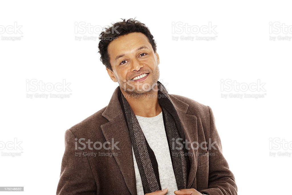 Confident mature man looking at camera against white royalty-free stock photo