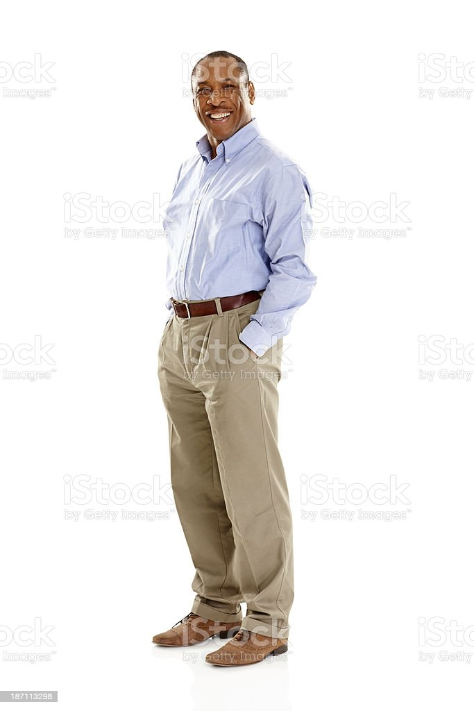 Confident mature man standing with his hands in pockets stock photo