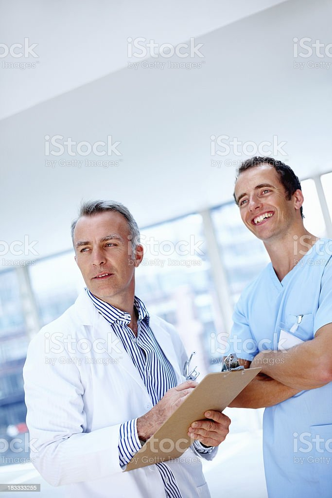 Confident medical professionals looking into distance royalty-free stock photo