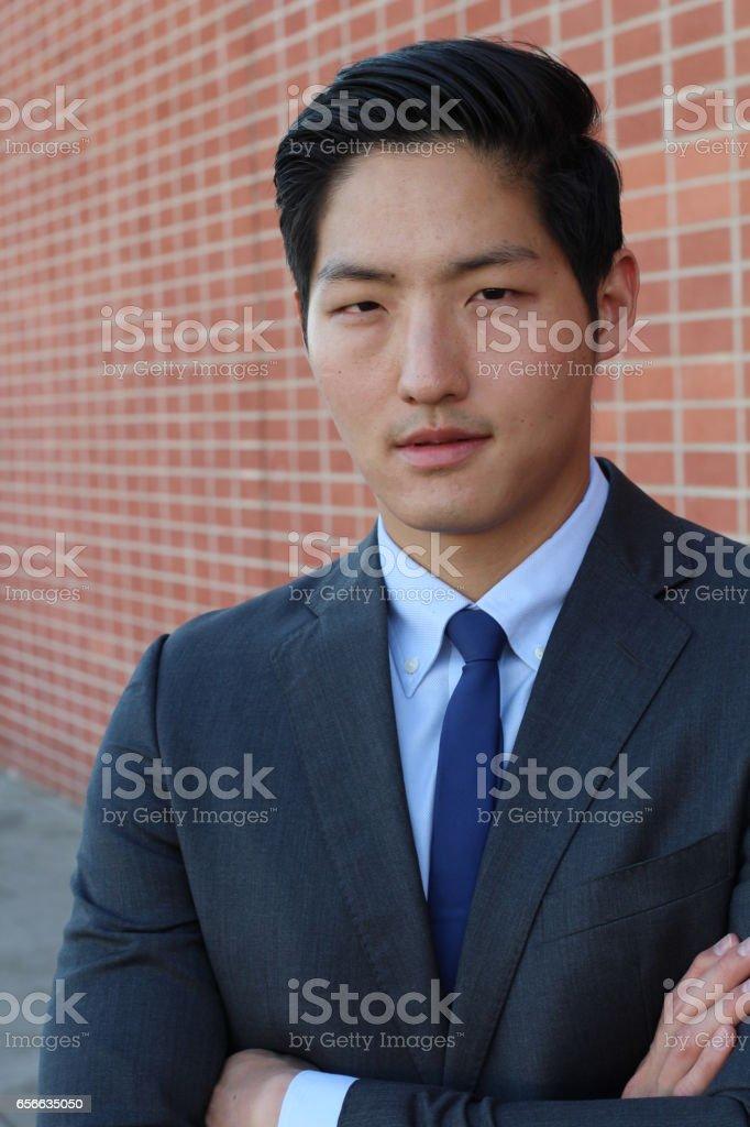Confident modern Asian business man stock photo