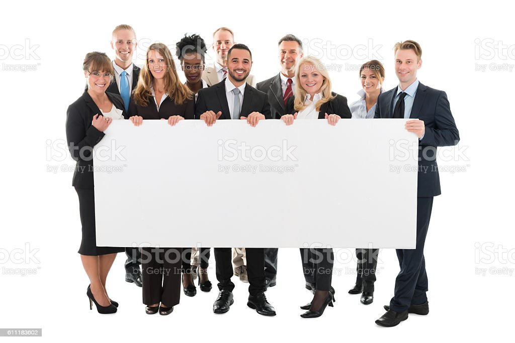 Confident Multi ethnic Business Team Holding Blank Billboard stock photo