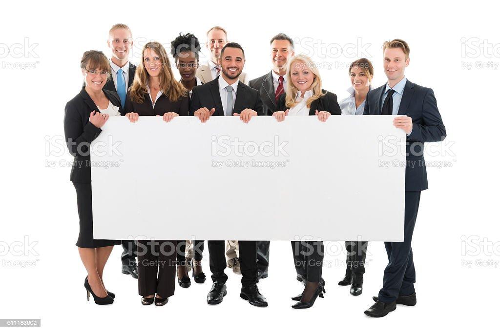 Confident Multi ethnic Business Team Holding Blank Billboard stock photo