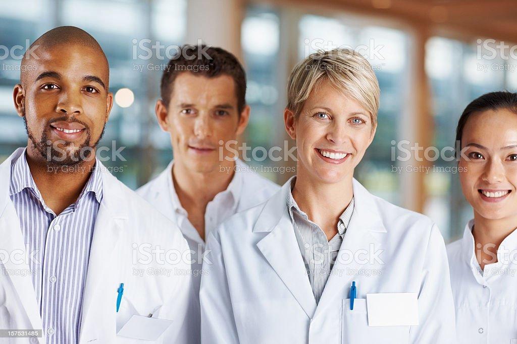 Confident multi racial doctors smiling stock photo
