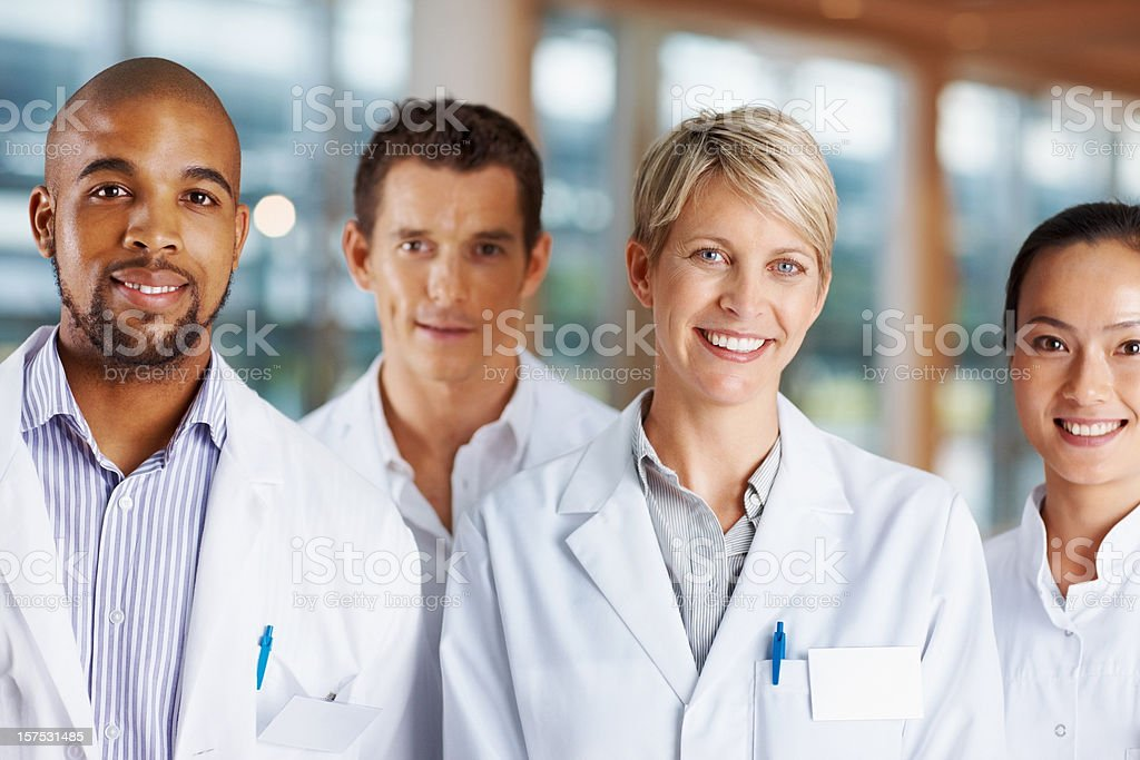 Confident multi racial doctors smiling stock photo