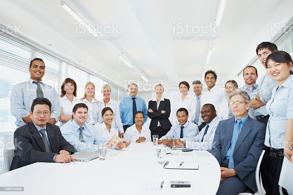 Confident multiethnic business executives in a board room royalty-free stock photo