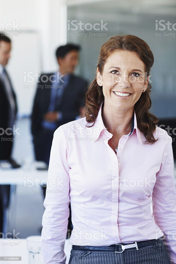 Confident of her position in this company stock photo