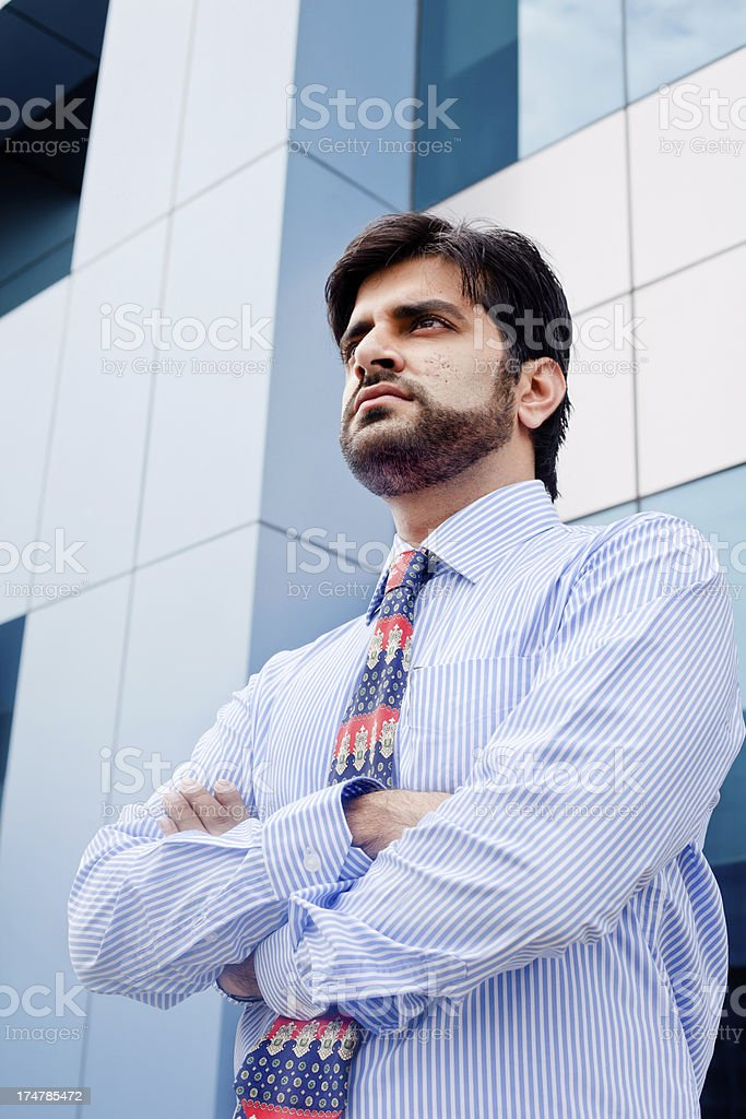 Confident Pensive Young Indian Businessman royalty-free stock photo