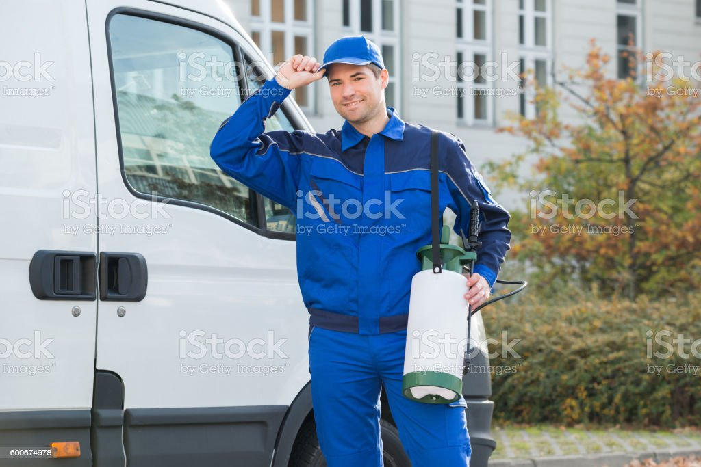 Confident Pest Control Worker Wearing Cap stock photo