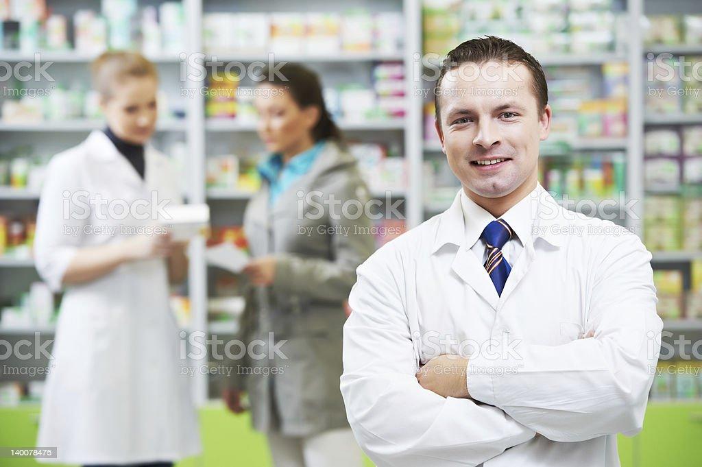 Confident pharmacy chemist man in drugstore royalty-free stock photo