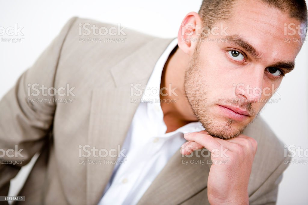 Confident pose from a suit wearing male model stock photo
