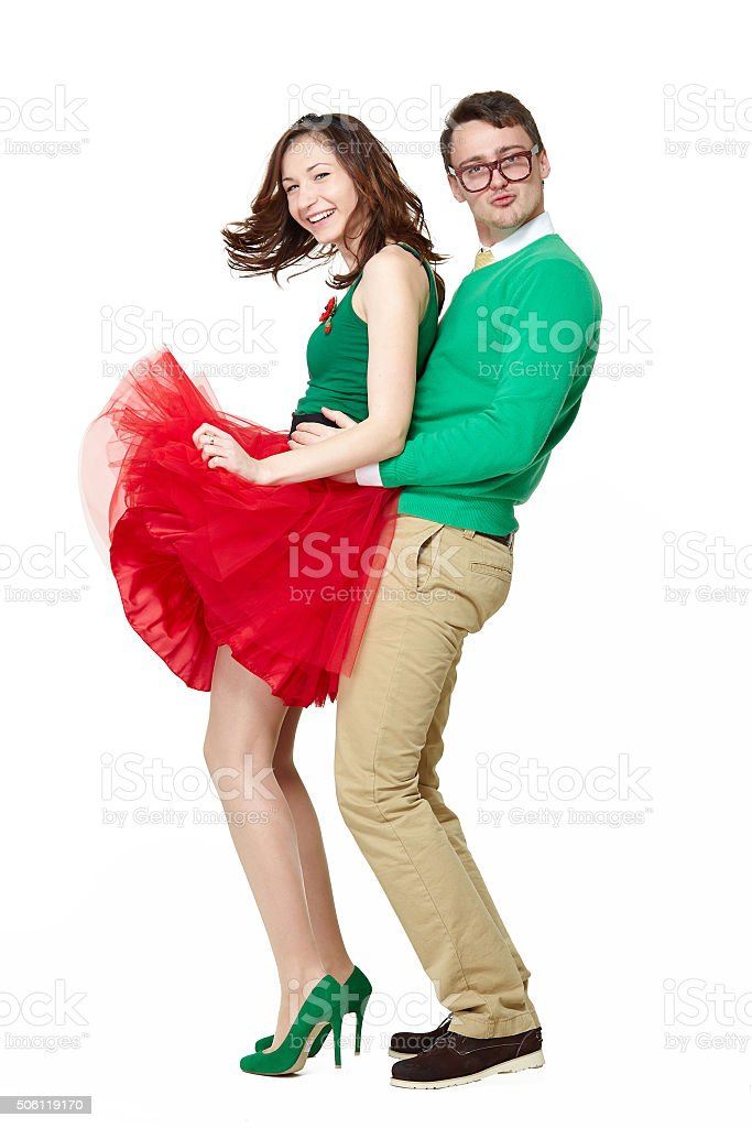Confident positive young couple dancing stock photo