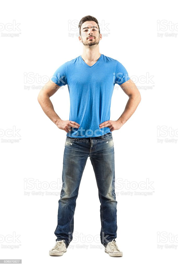 Confident proud young male in akimbo pose stock photo