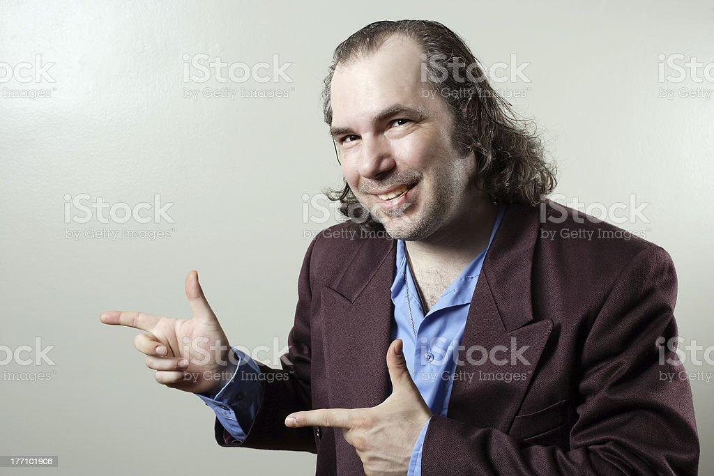 Confident salesman pointing stock photo