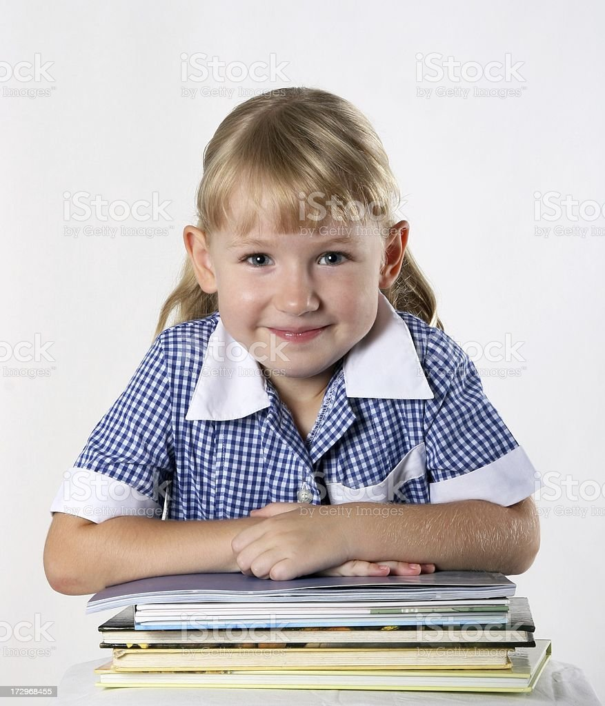 Confident School Girl in school uniform with books royalty-free stock photo
