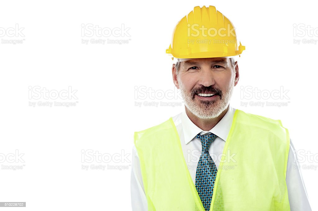 Confident senior architect with jacket and hard hat stock photo