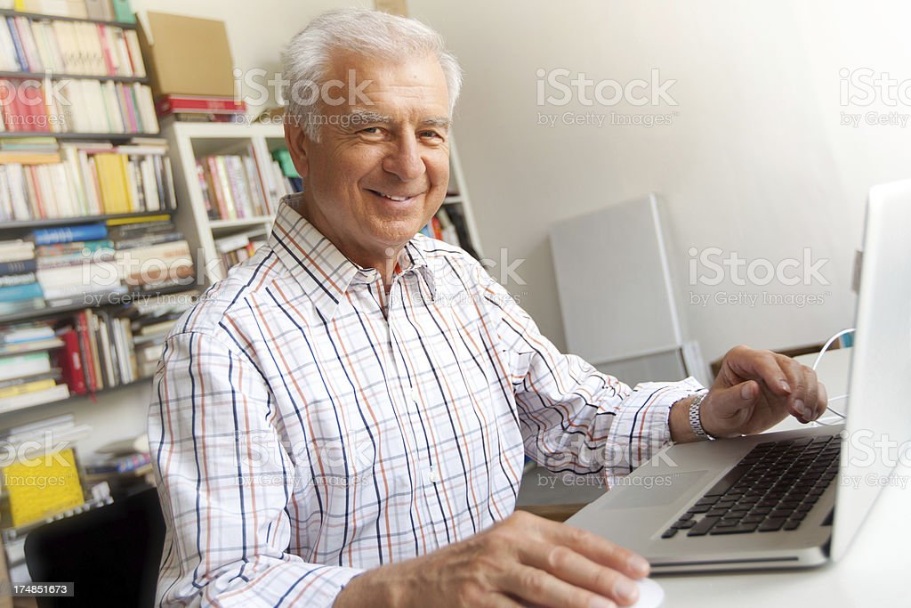 Confident senior at the computer royalty-free stock photo
