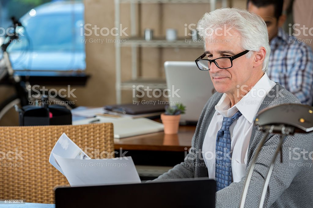 Confident senior businessman at the office stock photo