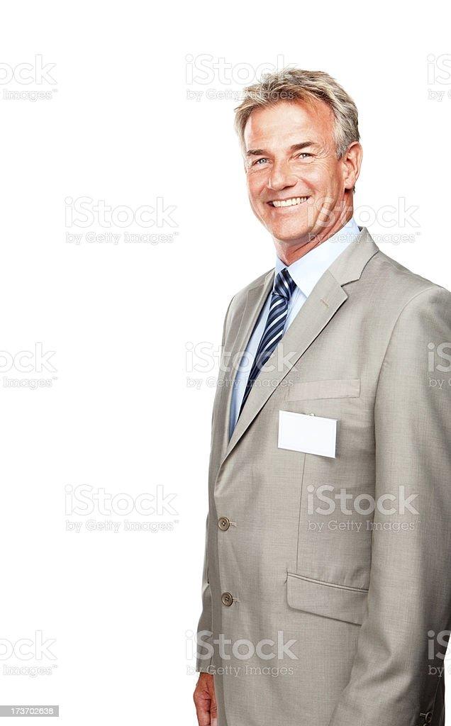 Confident senior businessman wearing a badge royalty-free stock photo