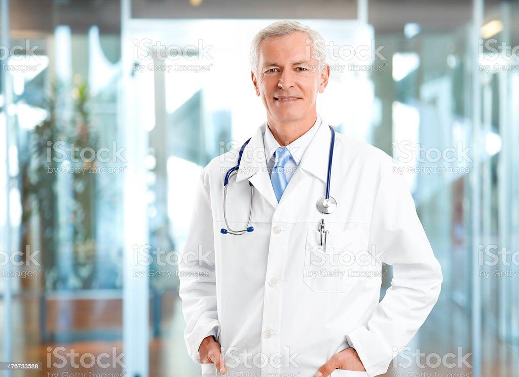 Confident senior doctor stock photo
