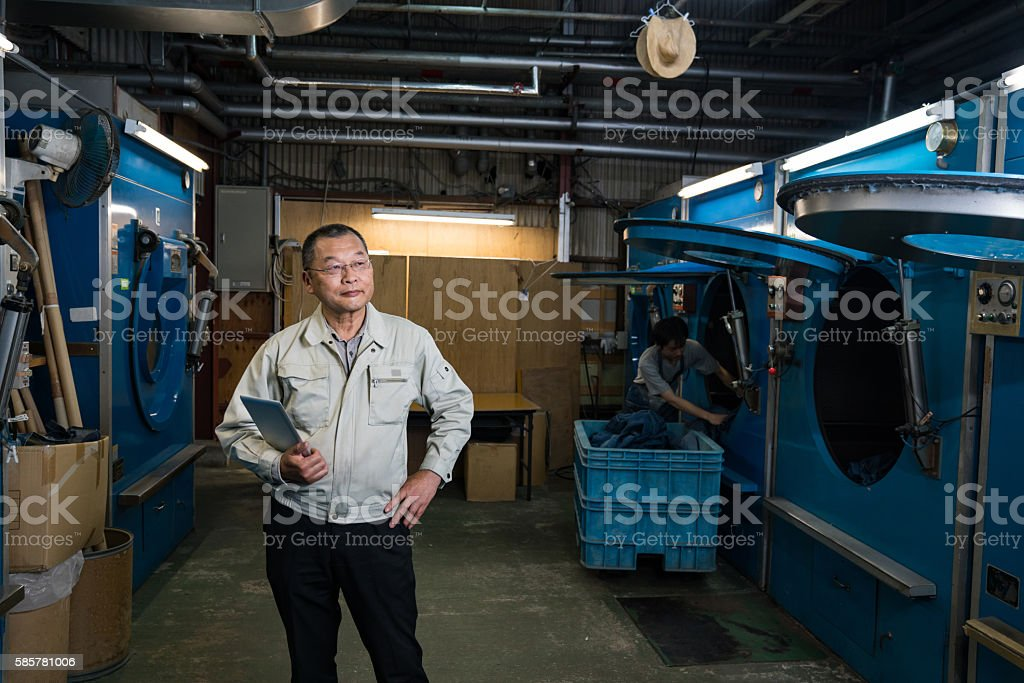 Confident senior industry manager in his textile factory stock photo