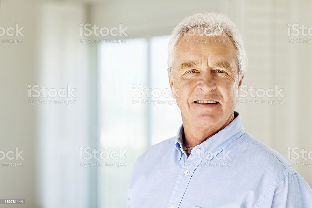 Confident Senior Man Smiling At Home royalty-free stock photo