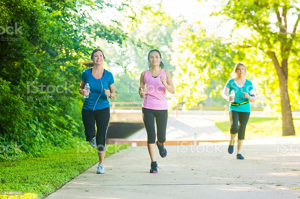 Confident senior women jog in the park stock photo