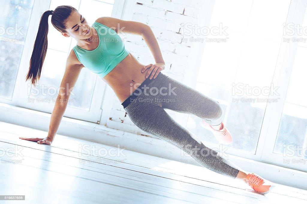 Confident side plank. stock photo
